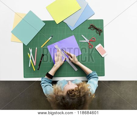 Woman Cutting Paper Stationery Workstation Concept