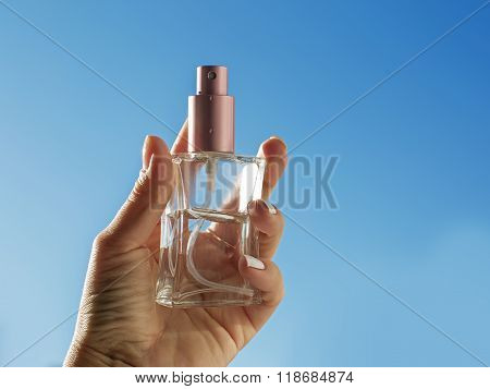 Perfume In A Female Hand