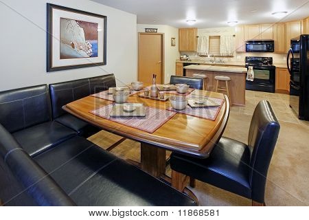 Dining Room With Black Leather And Kitchen View