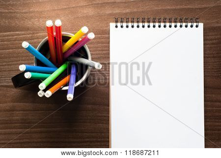 A Set Of Markers And Sketch Pad