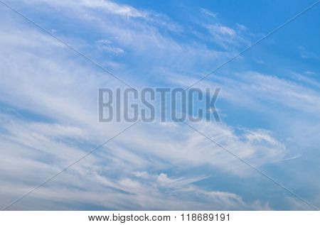 Blue Sky With White Fluffy Clouds On Winter
