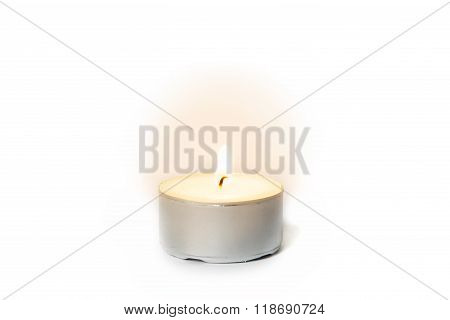 Shining Flame On A Tea Light Candle