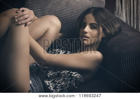 Stunning Woman Relaxed On Sofa
