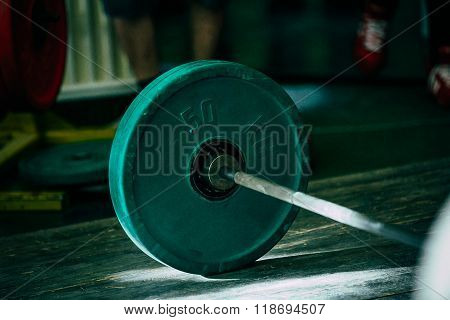 closeup of green barbell plates