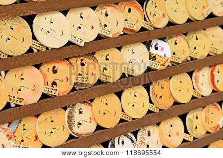 Shallow depth of field of mirror-shaped wooden preyer tablet in Kyoto, Japan. It is believed to paint the face, make a wish and your face will become more beautiful
