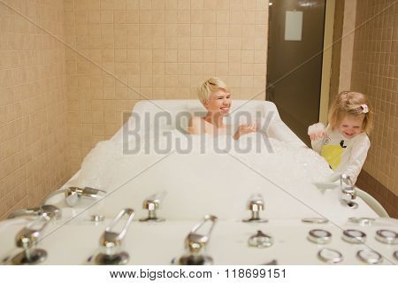 A woman and a hydro massage. She receives medical treatments for relaxation.