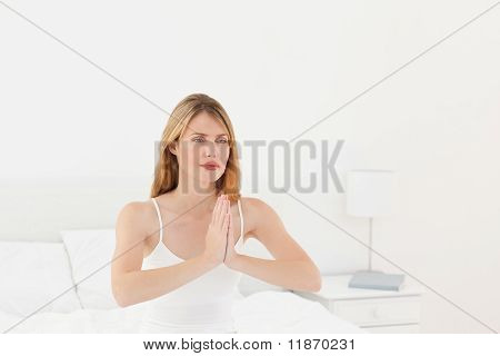 Woman Practice Yoga On Her Bed