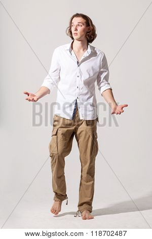 Young Caucasian Male Model Man Throws Up Hands