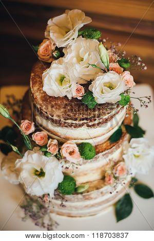 Wedding cake with roses whipped cream