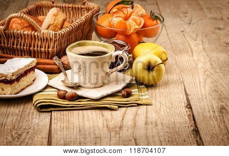 Morning breakfast with coffee and fruits. Tangerines. Lemon and sweet jam on wooden board in rustic style