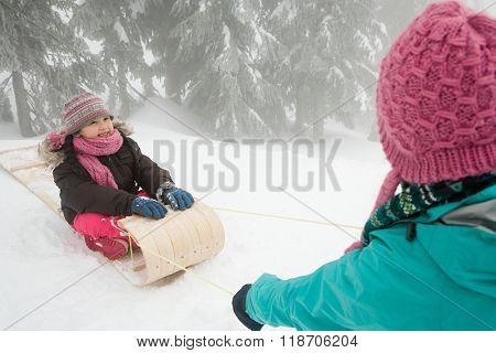 Girl on toboggan