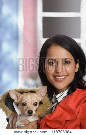 Young woman with pet chihuahua