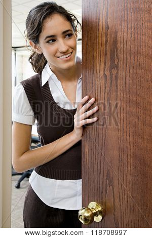 Young woman by door