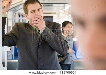 Commuter yawning
