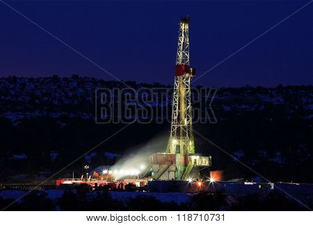 Nighttime photograph of a large oil drilling rig
