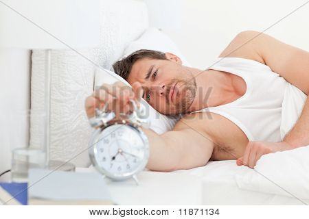 A Unhappy Man In His Bed Before Waking Up