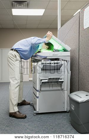 Man photocopying his head
