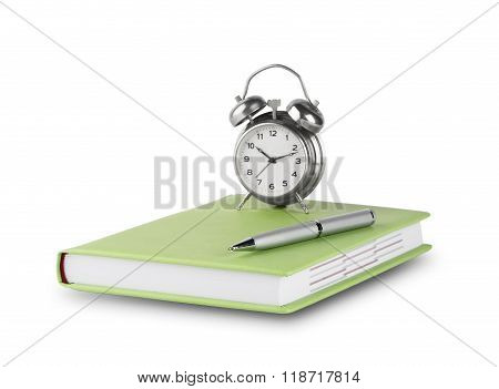 Diary with pen and alarm clock