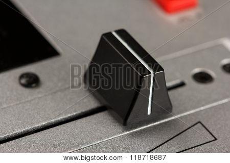 Cross fader of a DJ mixer