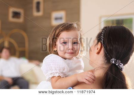 young mother with a daughter at home