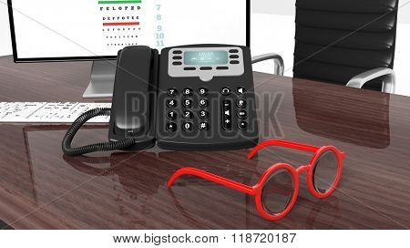 Eyeglasses set on wooden desktop with eyesight test on computer monitor