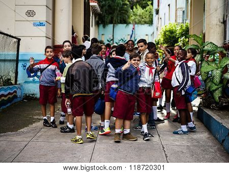 Group With Schoolchildren Standing In Front Of Their School