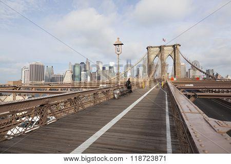 Policemen Waiting For Bike Run On Brooklyn Bridge New York In Golden Light