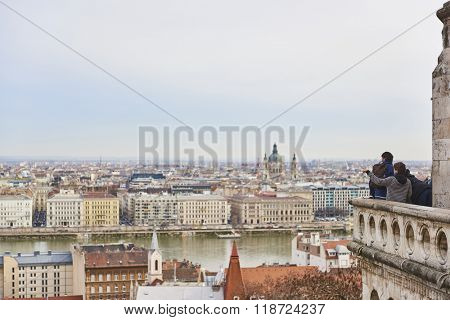 BUDAPEST, HUNGARY - FEBRUARY 02: Tourists enjoying the view on balcony at Fisherman's Bastion, at the Old Town district, with cityscape in the background. February 02, 2016 in Budapest.