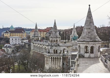 BUDAPEST, HUNGARY - FEBRUARY 02: Cropped shot of Fisherman's Bastion's spires, with statue of Saint Stephen in the background. February 02, 2016 in Budapest.
