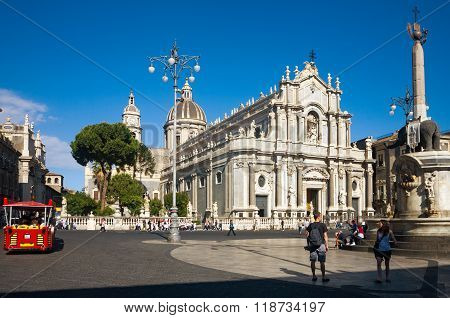 CATANIA ITALY - MAY 09 2012: Tourists at Catania town main square center with the Cathedral of Santa Agatha and the Elephant statue in Sicily Italy