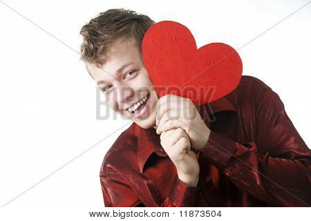 White Young Man Has Hidden For Red Heart And Looks Out