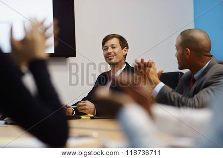 Business Man Doing Presentation And People Applauding In Meeting Room