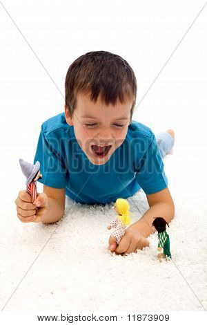 Boy Playing Aggressive Games With Puppets