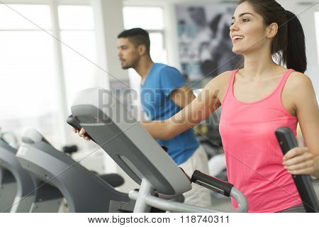 Young Multiracial People Training In The Gym