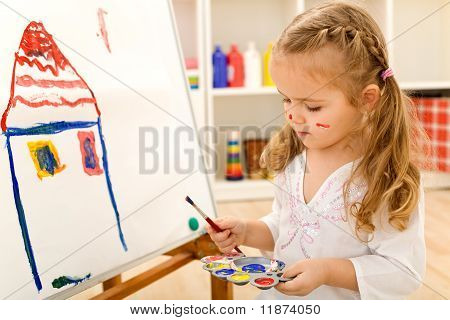 Little Artist Girl Painting On Large Paper Canvas