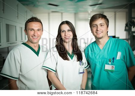 Young experienced doctor dentist standing along with his nurse assistants