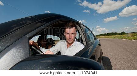 Oung Businessman In The Car