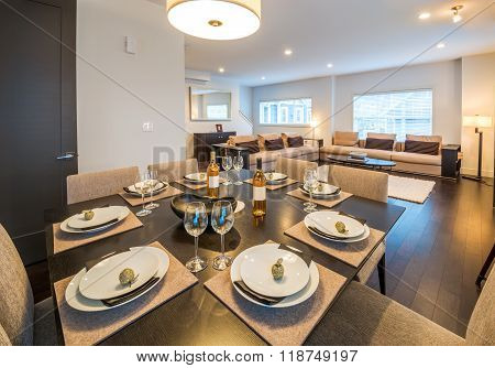 Table set for dinner in a spacious modern dining room. Interior design.
