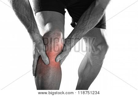 Young Sport Man With Athletic Legs Holding Knee With Hands In Pain After Suffering Injury Running
