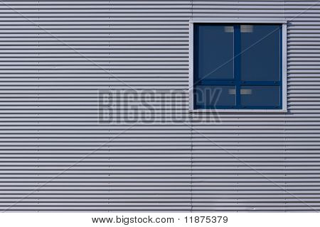 Building With Metal Panels And One Window