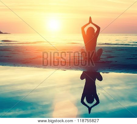 Meditation, serenity and yoga practicing at sunset.