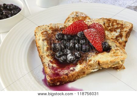 French toast with blueberries and strawberries.