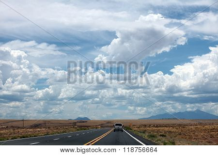 ST. GEORGE, UTAH -- JULY 8, 2014 -- A desolate highway in rural Utah winds through the desert under a dramatic sky.