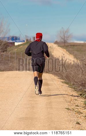 Back View Of Male Jogger Wearing Black Clothes