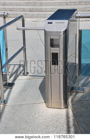 Metallic Turnstile In The Street