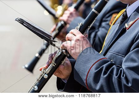 Musicians In The Military Orchestra Playing On Clarinet