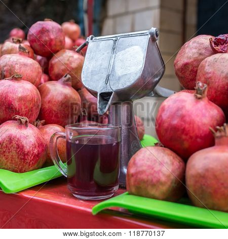 Traditional way to make delicious pomegranate juice on the streets of Tehran, Iran