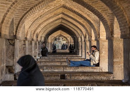Isfahan, Iran - December 11, 2015: Pol-e Khaju bridge, across the Zayandeh River, in Isfahan, Iran.