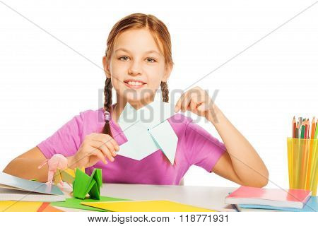 Schoolgirl with paper origami fan in her hand