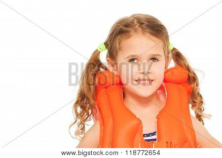 Portrait of smiling little girl in lifejacket